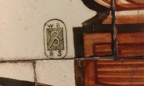 W.B. Simpsons logo on tile